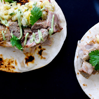 Pork Carnitas Tacos with Jalapeño Corn Salsa and Avocado Crema.