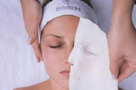 a lady having a face mask taken off with an environ headband