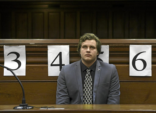 EXPRESSIONLESS   Murder-accused Henri van Breda listens to blood splatter expert Captain Marius Joubert giving evidence at his trial in the Cape Town  High Court.