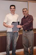 Photo: Jonah Sherman accepting the David J. Sakrison Memorial Prize.