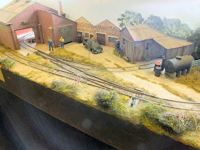 Photo: 005 Howard Martin is a stalwart member of the Small & Delightful Group as well as running his own Avalon Lines 7mm scale resin rolling stock kits business. Here is the familiar sight of the demonstration layout on his stand .