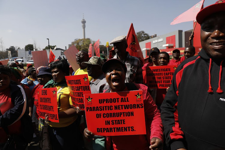 Members of the SACP demonstrate against state capture outside the Zondo Commission of Inquiry in Parktown on August 24, 2018.