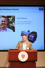 Photo: Keith Muhart addresses the crowd before gifting the finalists with Toq smartwatches from Qualcomm Ventures