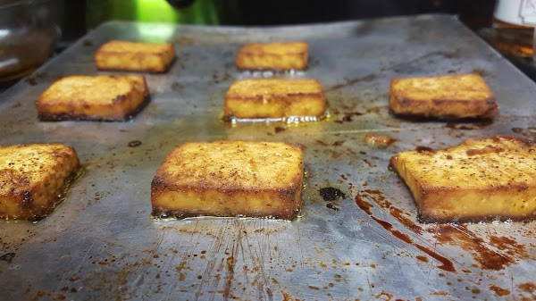 Once tofu has been pressed of excess moisture, remove from between the towels and...