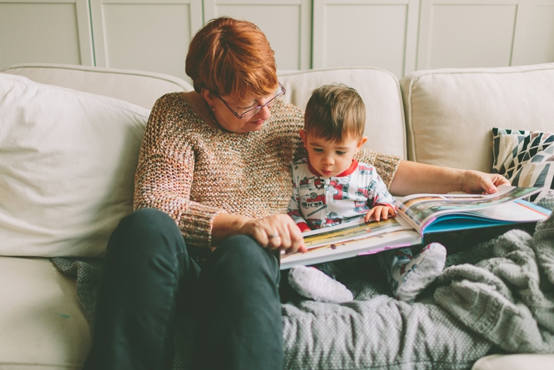 Nanny reading to child before bed.