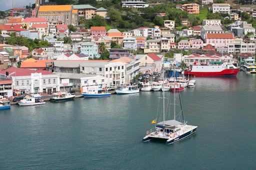grenada-catamaran.jpg - A catamaran glides into the marina at St. George's, Grenada.