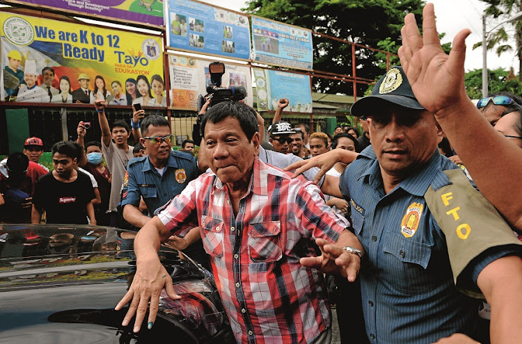 "A vocal anti-crime politician likened to US presidential hopeful Donald Trump, Rodrigo ""Digong"" Duterte, votes soon before being declared the winner of Philippines' presidential election after the withdrawal of his main rivals. Picture: GALLO IMAGES/AFP/NOEL CELIS"