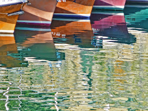Photo: Boat reflections in San Sebastian harbour.