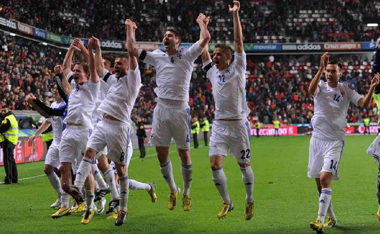 Alt: The Finland soccer team players celebrate after winning - Photo by Denis Doyle/Getty Images