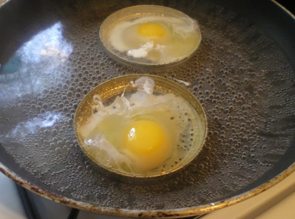 Gently break eggs into the lids as shown.  (If you aren't using lids...