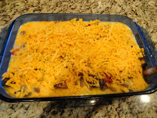 Sprinkle sausage mixture over cornbread; pour egg mixture on top, cover with cheese.