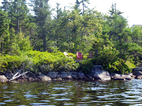 Photo: July 22. Most residences on the lake have retained largely natural landscapes by the shore.