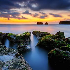 Eternal Silence by Hendri Suhandi - Landscapes Sunsets & Sunrises ( bali, sunset, melasti, mood, stone, long exposure, rock, beach )
