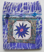 Photo: Stenciled muslin with tea bag, fibers, and focal point sewed on.