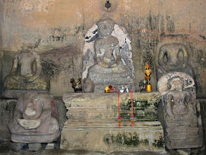 Photo: ancient Buddha images in a rock temple structure