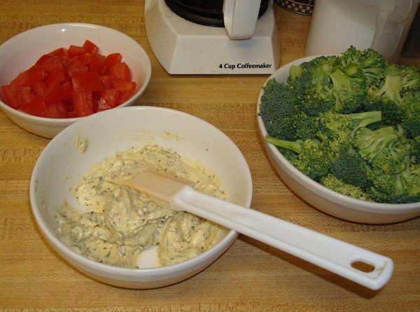 In a bowl, mix together butter and dijon mustard. Stir in garlic, green onions,...
