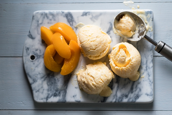 Vanilla ice cream with canned peaches in syrup.