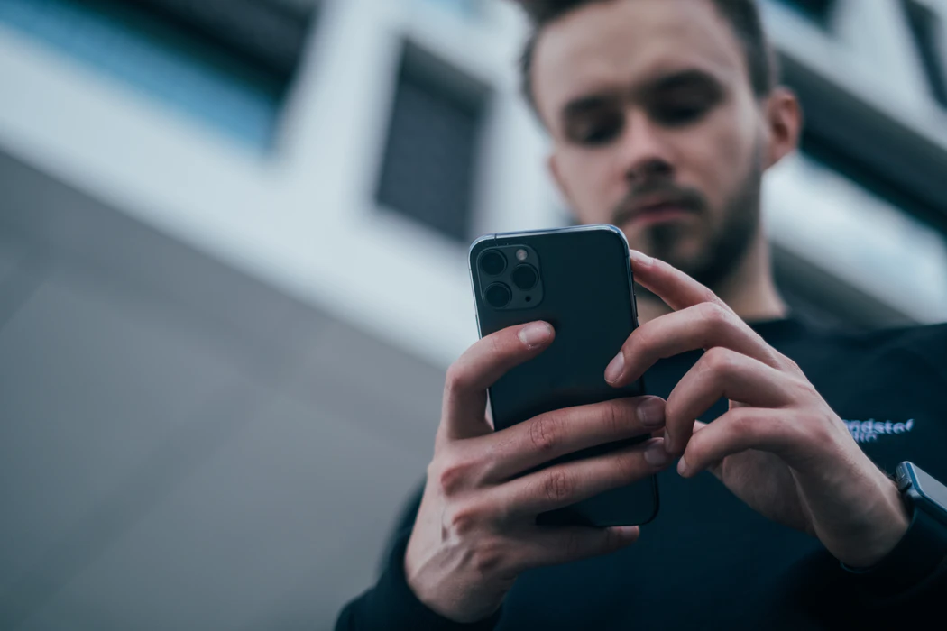 man using phone to interact with influencers