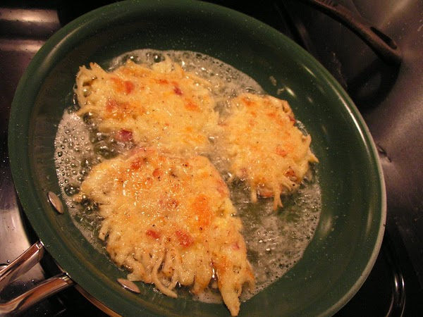 Heat about 1/2 inch vegetable oil in frying pan to about 350 degrees. ...
