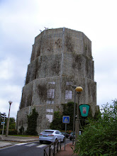 Photo: This odd looking structure is not some prehistoric monument or alien artifact, but a concrete water tower covered in chain link to minimize debris on the adjoining road.