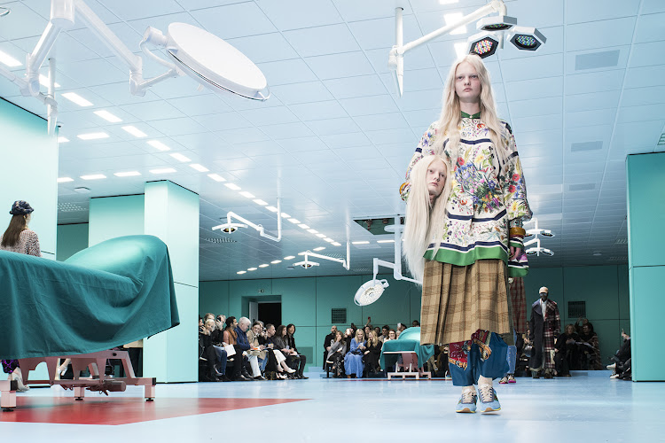 "Alessandro Michele had drawn on a ""post-human"" Gucci cyborg to find his theme — and staged his show in a brutal, overlit surgical theatre"