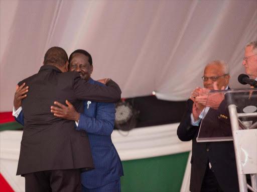 President Uhuru Kenyatta and ODM leader Raila Odinga hug during the National Prayer Breakfast meeting at Safari Park hotel, Nairobi on Thursday, May 31, 2018