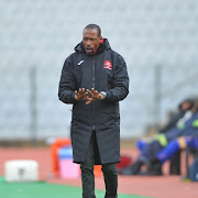 TS Sporting head coach Benson Mhlongo insists he is still employed by the club despite the appointment of a new coach on a caretaker role.