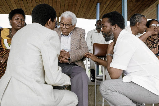 Leaders in exile: Henry Makothi, Walter Sisulu and Thabo Mbeki (Tanzania, 1990)