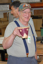 Photo: Bob Grudberg shows his segmented bowl that he brought in for the Bring-back Challenge.