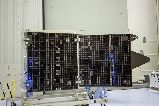 Inside the Payload Hazardous Servicing Facility technicians deploy the solar arrays for the Mars Atmosphere and Volatile Evolution.