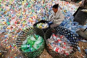 Photo: A worker separates plastic bottles at a recycling depot in Beijing May 23, 2013. According to government figures, reported in local media, about 4.67 million tons of recyclable waste was collected in Beijing in 2010. In the same year, 6.35 million tons of trash ended up in landfill in the city. World Environment Day is celebrated annually on June 5. Picture taken May 23, 2013. REUTERS/Kim Kyung-Hoon (CHINA - Tags: ENVIRONMENT SOCIETY)
