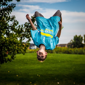 Flying by Richard States - Babies & Children Children Candids ( playing, jumping, blue, fun, boy,  )