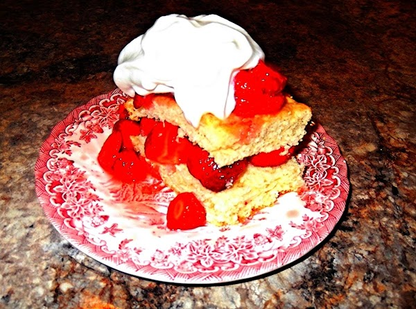 TO SERVE: Cut cooled cake into square piece. Split piece in half horizontally. Place...