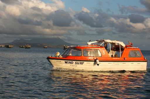 wind-surf-tender.jpg - A tender departs Wind Surf in the late afternoon in St. Barts.