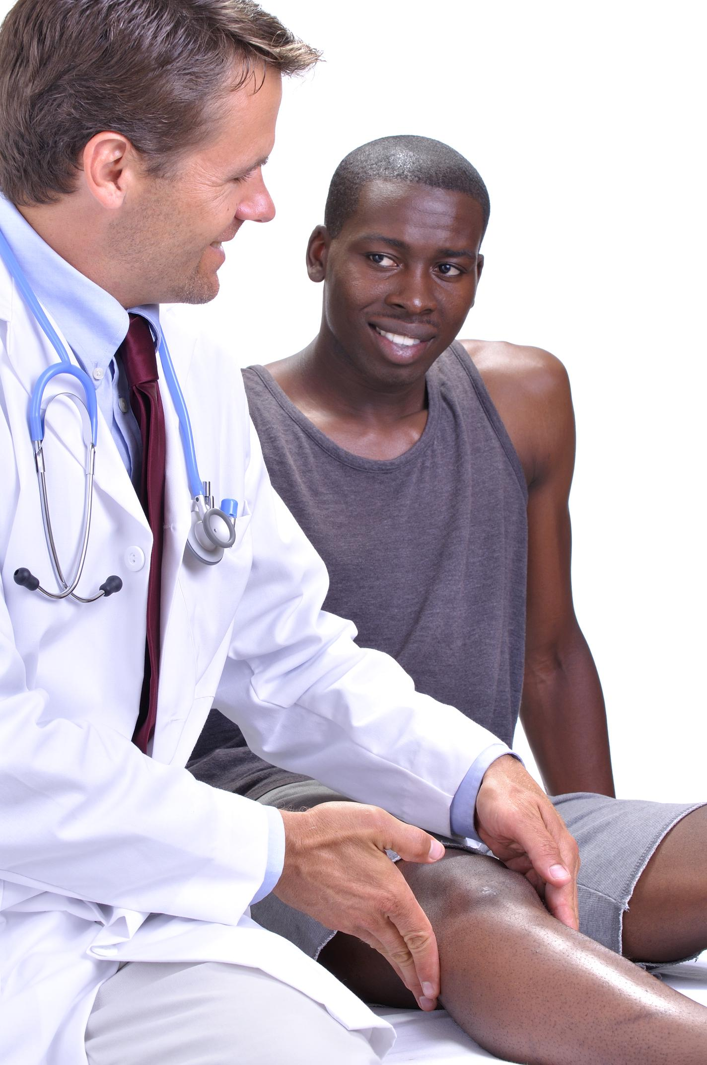 Doctor examining an athlete