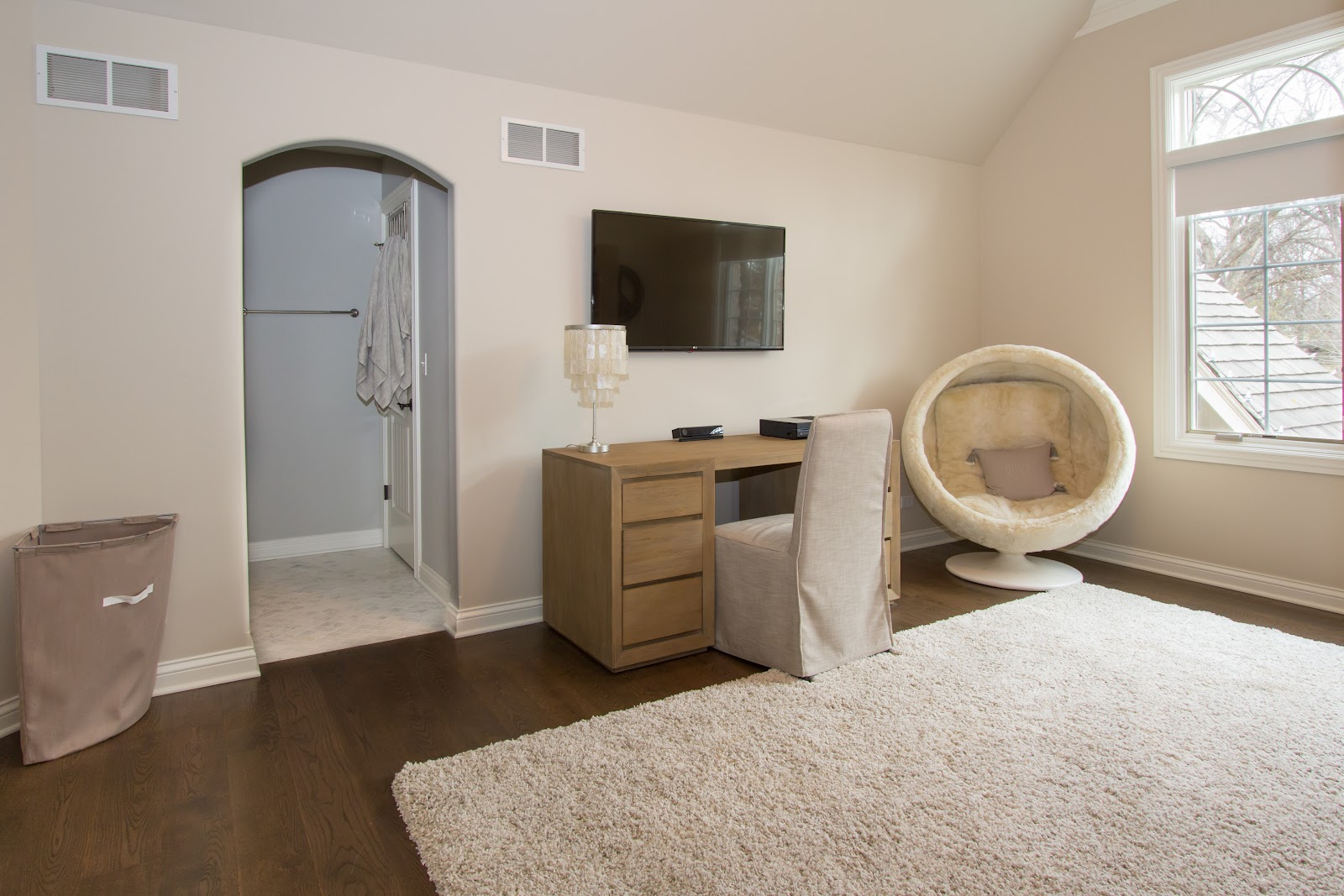 Bedroom suite with television, desk and bathroom.