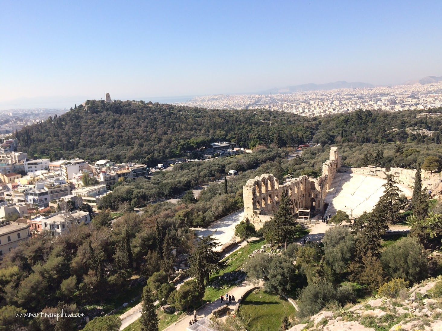 Filopappou hill with a monument at the top (left), Odeon Herodes Atticus (front), Athens, Greece