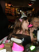 Photo: the bday girl goes in for her cupcake