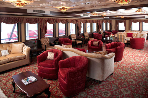 Queen-of-the-Mississippi-Paddlewheel-Lounge.jpg - Head to the vintage-inspired Paddlewheel Lounge on deck 2 of  your American Cruise Lines ship and relax between calls on port cities.