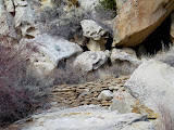 Photo: Rock wall across the creek