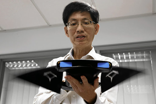 FIN-ISHED PRODUCT Chew Chee Meng of the National University of Singapore shows the aquatic robot manta ray MantaDroid Picture: Edgar Su/Reuters