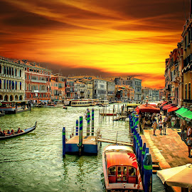 The Grand Canal by T Sco - City,  Street & Park  Historic Districts ( sidewalk, dusk, boat, building, stone, gondola, gondaleer, venice, golden hour, daylight, sunset, foot traffic, hotel, pedestrian, canal, evening, italy, walk, apartment, architecture )