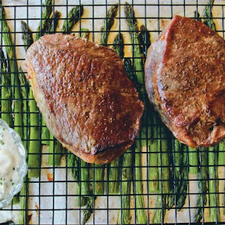 Broiled Steak and Asparagus with Feta Cream Sauce.