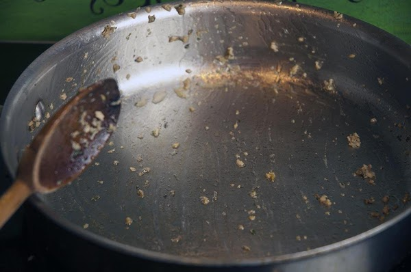 Pour out any remaining grease from the skillet, and discard.