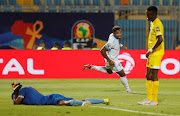 DR Congo's Britt Assombalonga celebrates scoring their fourth goal against Zimbabwe during an Afcon match. Zimbabwe are facing allegations and accusations of match-fixing at the on-going Africa Cup of Nations in Egypt.