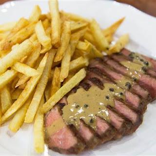 Steak Frites with Au Poivre, Bearnaise and Bordelaise Sauces.