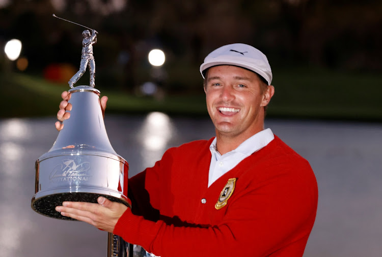 Bryson DeChambeau holds the champion's trophy after winning the Arnold Palmer Invitational golf tournament at Bay Hill Club & Lodge in Orlando, Florida, the US, on March 7 2021. Picture: REINHOLD MATAY/USA TODAY SPORTS