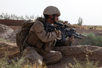 Photo: A U.S. Marine with Bravo Company, 1st Reconnaissance Battalion, 1st Marine Division (Forward), provides security during a patrol of the local area in Southern Trek Nawa, Afghanistan, Aug. 09, 2010. The Marines and sailors of Company B are currently conducting counter insurgency operations in support of the International Security Assistance Force. (U.S. Marines Photo by SSgt. Ezekiel R. Kitandwe /Released)
