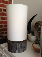"Photo: $40. West Elm Round Uplight Table Lamp. Natural materials, textured white cotton shade. Base: Hand-hammered metal or bone. Shade: Textured white cotton. Harp and finial: Iron. 6.5""diam. x 12.5""h. (one wood chip missing)."