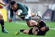 South Africa's Aphiwe Dyantyi is tackled by New Zealand's Aaron Smith.